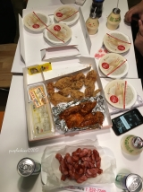 our takeout dinner plus free sausages from our host!